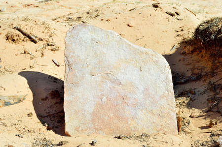 Stone tombstone at a funeral in the desert with copy space