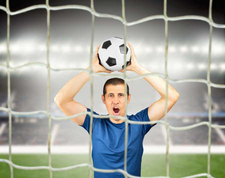 Cropped shot of a young soccer player celebrating his victory at stadium