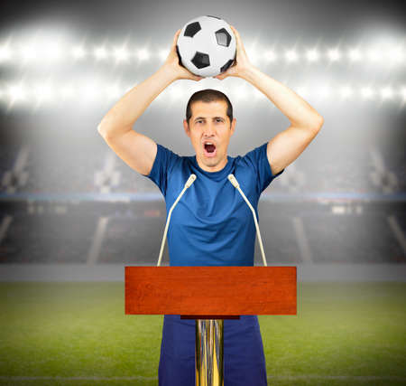 An podium with a young soccer player celebrating his victory at stadium Stock Photo