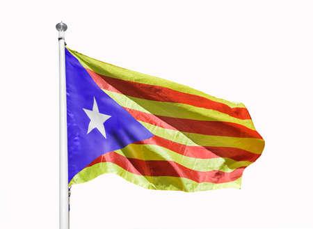 Close-up of catalan senyera flag with white background