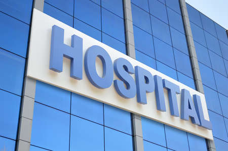 Hospital building sign closeup, with sky reflecting in the glass. 3d rendering