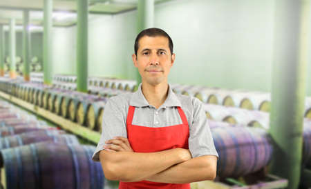 Shot of a handsome mature man standing in a wine cellar