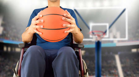 cropped basketball player in wheelchair at stadium