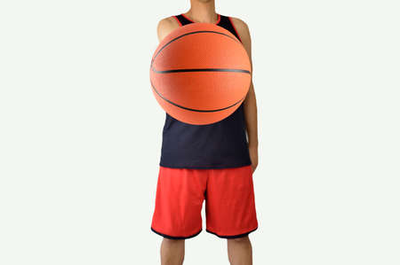 Studio shot of a basketball player with white background