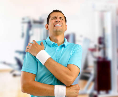 Shot of a young athlete with a shoulder injury at gym Stok Fotoğraf
