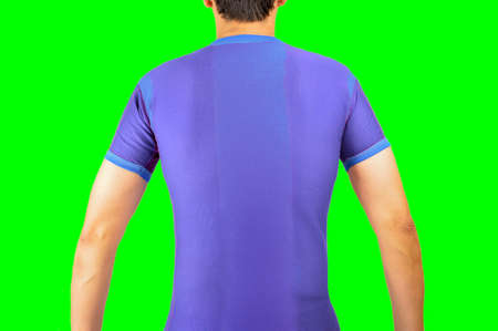 back of a football player with blue t-shirt.Isolated cutout on green background with chroma key.Rearview