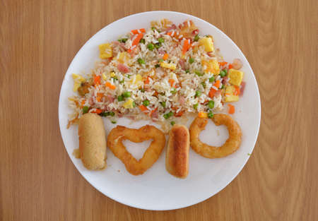 Squid rings to the romana,croquettes and chinese fried rice whit heart shape and word I LOVE YOU Banco de Imagens