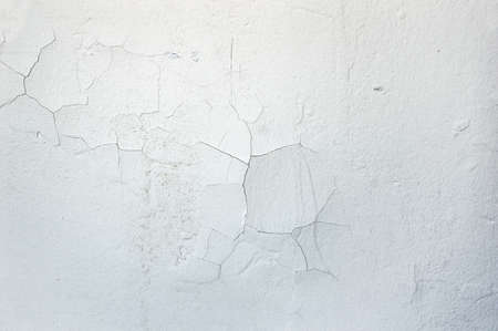 white wall cracked with moisture