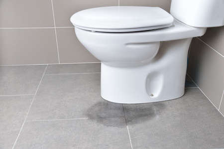Leakage of water from a toilet due to blockage of the pipe Stock fotó