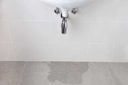 Water damage in home caused by due to clogged sanitary drain