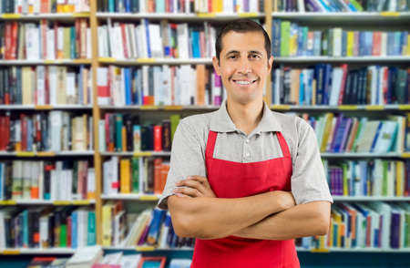 a worker at a bookstore smiling and looking at camera Zdjęcie Seryjne