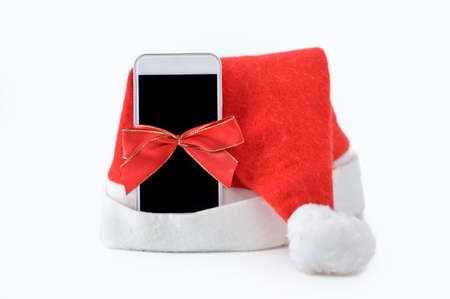 Close-up of phone christmas gift with a ribbon isolated on a white background