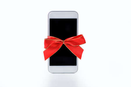 Close-up of phone gift with a red ribbon Stok Fotoğraf
