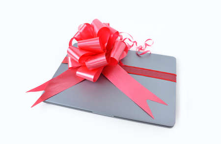 Close-up of laptop gift with a red ribbon