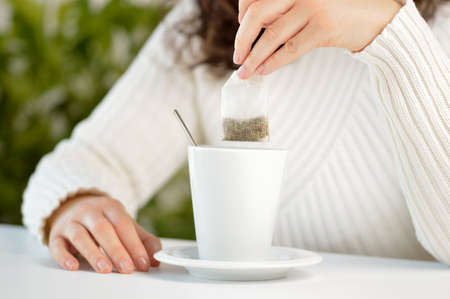 Closeup shot of an unrecognizable woman having a cup of tea