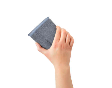 Woman hand holding a aluminum cleaning sponge isolated with white background Banco de Imagens