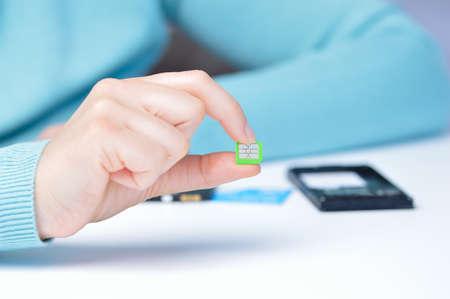 Woman hand holding a micro sim card