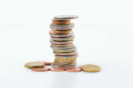 Many coins in column isolated on white Banque d'images