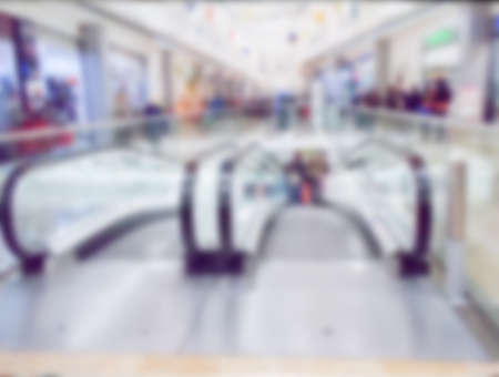 Abstract blur image of shopping mall with bokeh for background and modern escalator