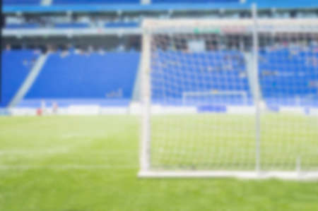 Unfocused or blurred rear view of a soccer goal in a stadium