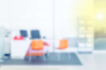 Blur in the workplace or work space of table work in office with computer or shallow depth of focus of abstract background