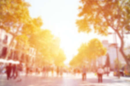 Blurred background. Blurred people walking through a city street