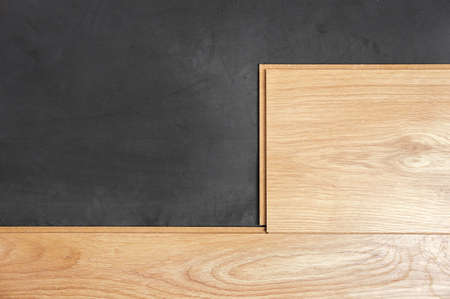 Laminated wood parquet with black insulation rubber