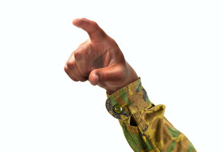 Cropped shot of an unrecognizable soldier hand pointing or pushing with forefinger on a white isolated background Reklamní fotografie