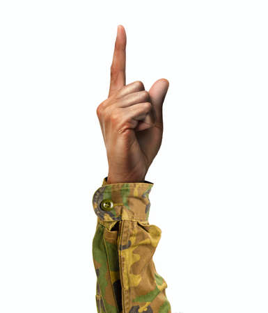 Soldier hand showing forefinger up and number one sign in a white isolated background