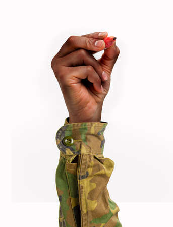 Soldier hand drawing in the air with a red marker on a white isolated background