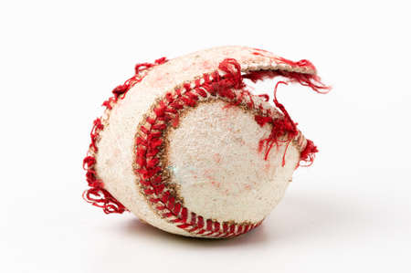 Baseball ball that is ripped and useless on white background Reklamní fotografie