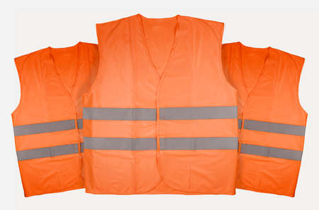 Three orange vests on white background