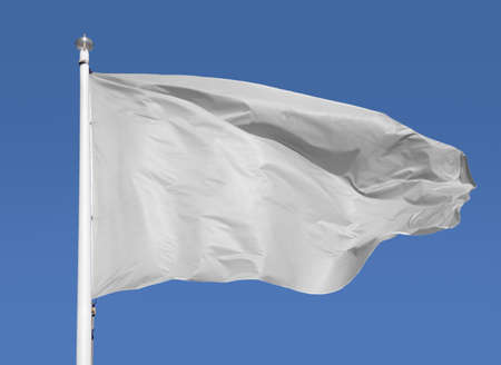 Empty white clear flag waving against clean blue sky and close up isolated Imagens