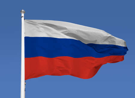 Shot of the russian flag blowing in the wind with sky background