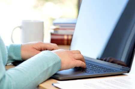 Cropped shot of an unrecognizable businesswoman working on his laptop while sitting in the home office