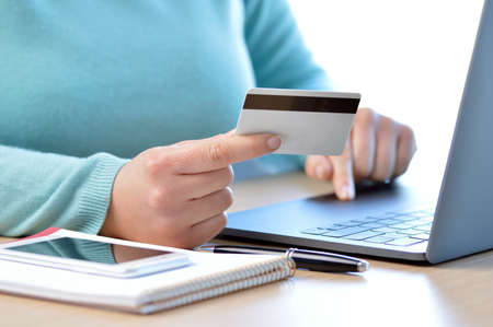 Woman hand paying on line with credit card at home Reklamní fotografie