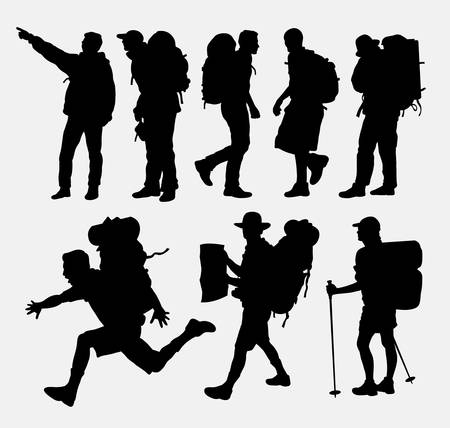 guy with walking stick: People hiking silhouettes