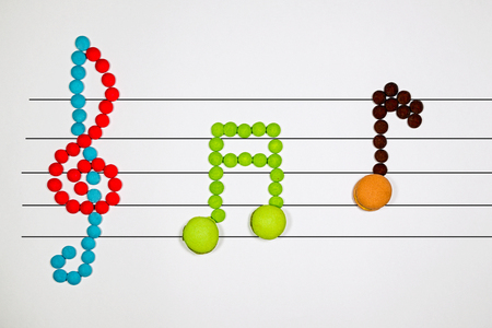 cian: musical notes of chocolate dragees and macarons