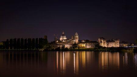 nightscape: Mantua nightscape reflection on the river Stock Photo
