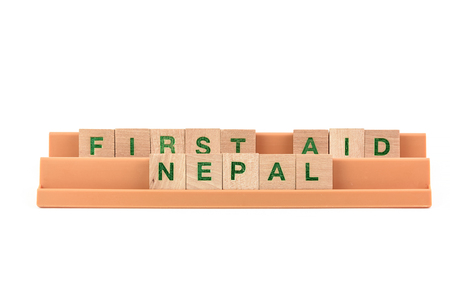 seismic: first aid nepal written with scrabble letters