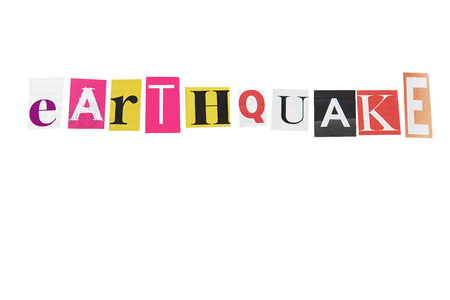 earthquake written letters daily on white background photo