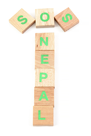 sos nepal written with wooden letters photo