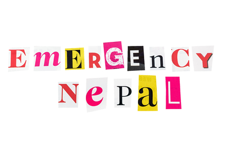 emergency nepal written with daily letters photo
