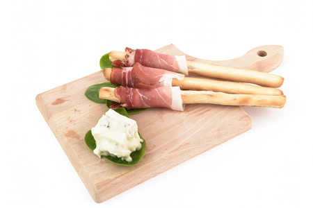 speck: breadstick with speck and gorgonzola on chopping board