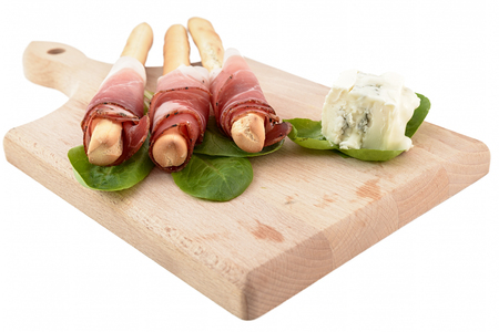 breadstick: breadstick speck and gorgonzola on chopping board