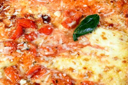 cherry tomatoes: pizza mozzarella and cherry tomatoes Stock Photo