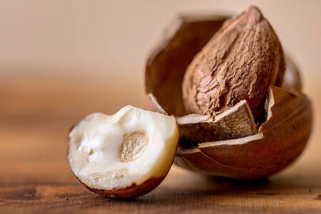 nutshell: hazelnut in nutshell on wood Stock Photo