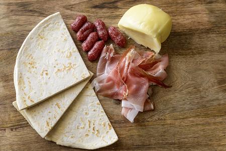 scamorza: piadina, speck, salami and scamorza Stock Photo