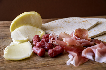 scamorza cheese: piadina, speck, salami and scamorza Stock Photo