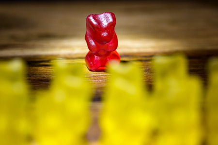 gummy bear: gummy bear all against one yellow against red Stock Photo